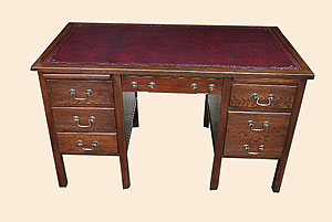"""1960's Oak 6 drawer desk with pull out brushing slides on 2"""" thick leg"""